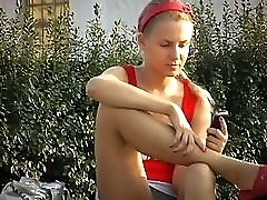 Voyeur upskirt pussy of unshamed blonde girl making a phone call in the park