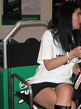 24 pictures - Young hotties flashing. Hot upskirts, at the exhibitions